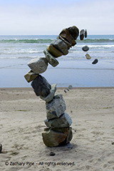 photo of a toppling rock tower at Stinson Beach, California. 7/27/05.