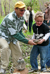 photo of Zach helping carry a rock. 11/15/07.
